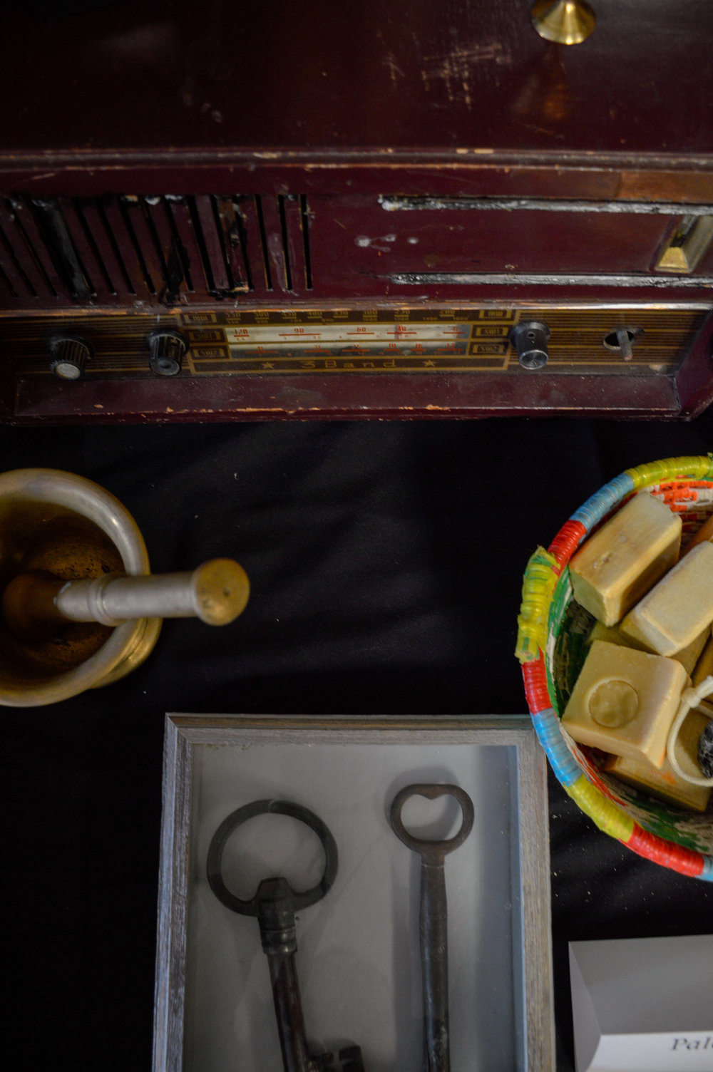 Artifacts on display at Broken Film Festival, including a pair of old keys and handmade soaps