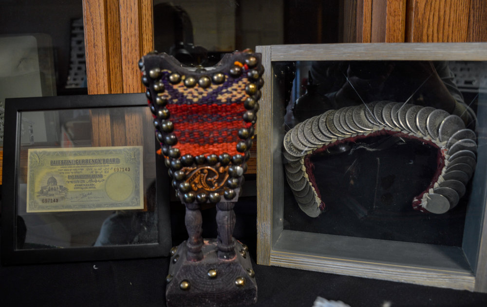 Artifacts on display at Broken Film Festival, including an ancient money bill and 'expensive' silver wedding wear for women
