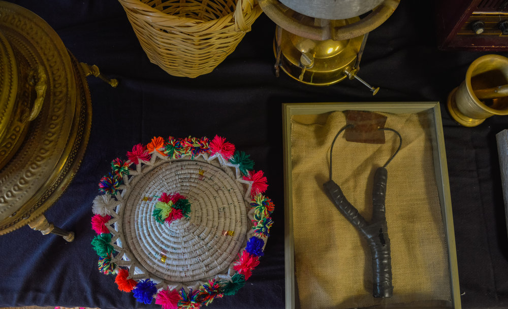 Artifacts on display at Broken Film Festival, including a slingshot and a basket for bread