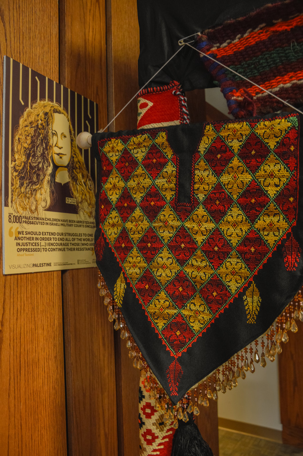 Artifacts on display at Broken Film Festival. Custom textiles/colors and more facts about the occupation in Israel/Palestine