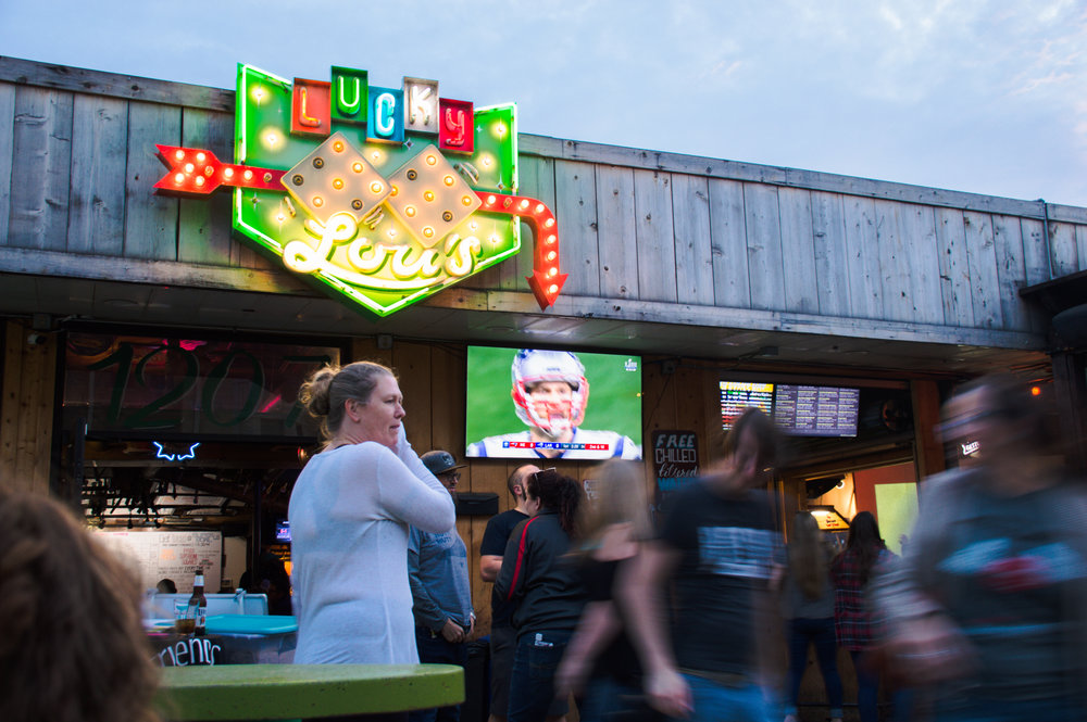 Fans watching the game outside at Lucky Lou's.
