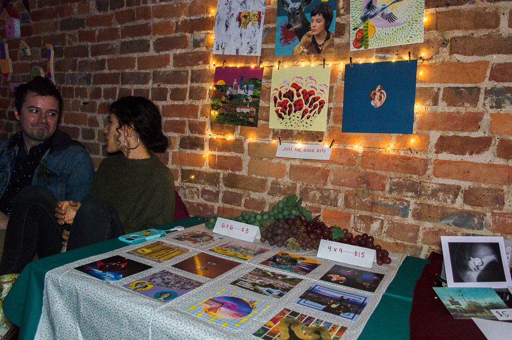 Tables were lined across Andy's wall to show different artists work - either postcards, prints, photographs, stickers, etc were all seen on the tables for purchase.