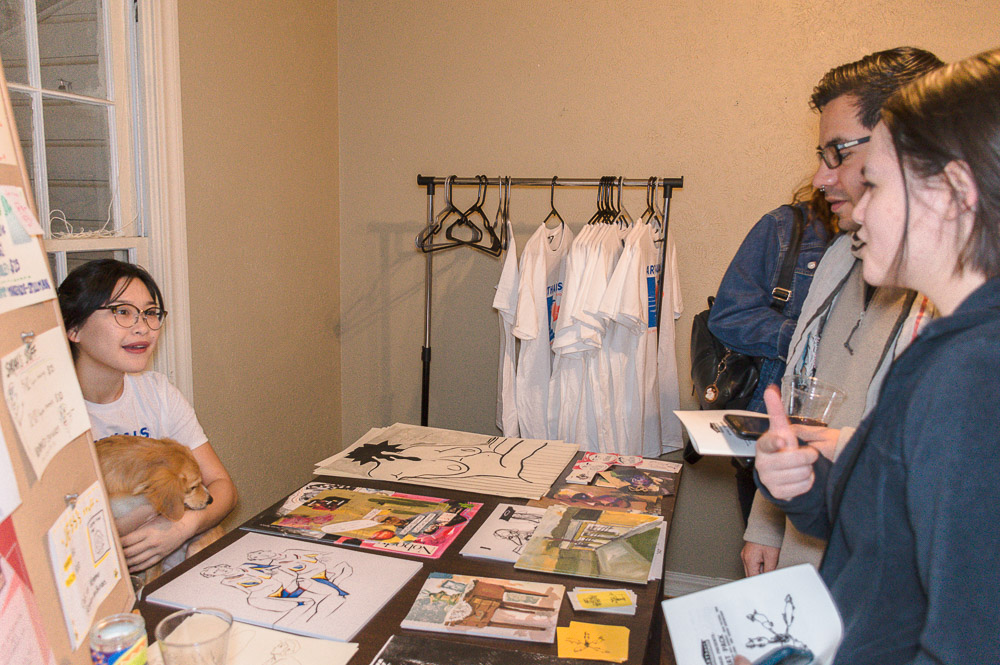 A table selling small prints, t-shirts and stickers made by the 'Rat Pack' artists were available for purchase.