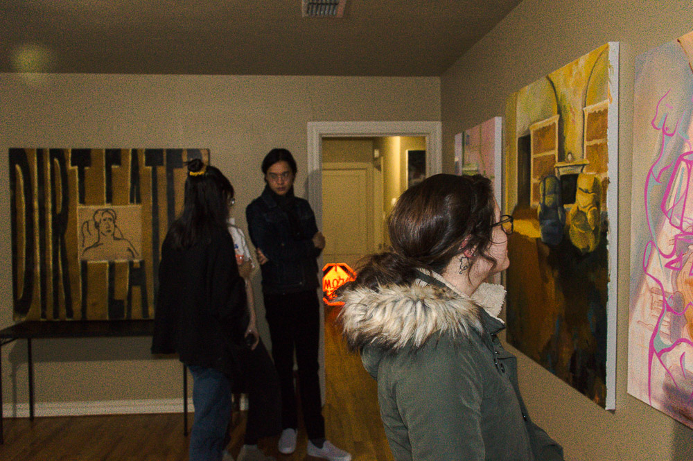Visitors gathering around the house that was cleared of all furniture in order to be transformed into a gallery space. Given room to talk and walk around the house to look through the 'Rat Pack's' paintings, visitors were encouraged to engage with the art and each other directly.