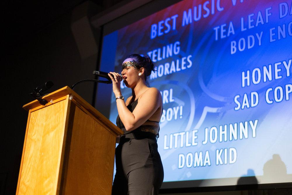 Tiffany Johnson presenting awards.