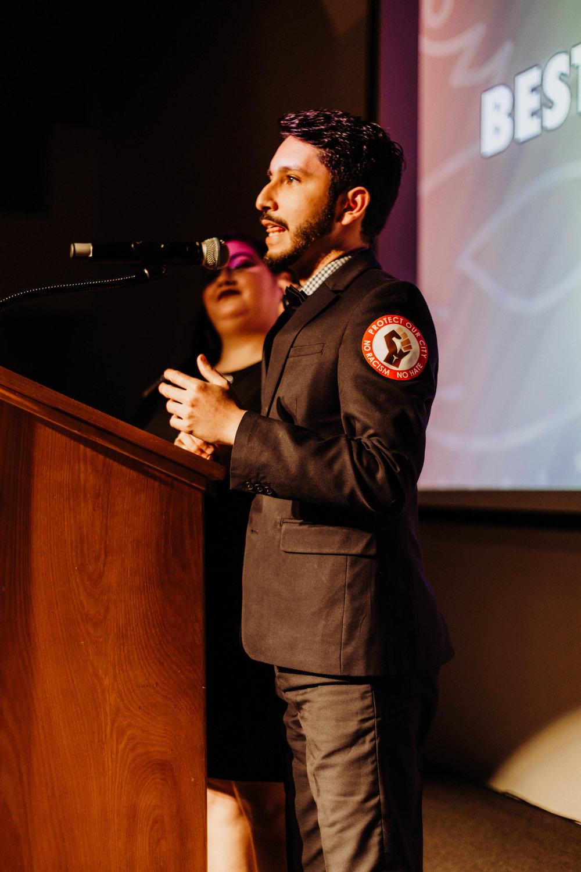 Samuel Escalante presenting awards.