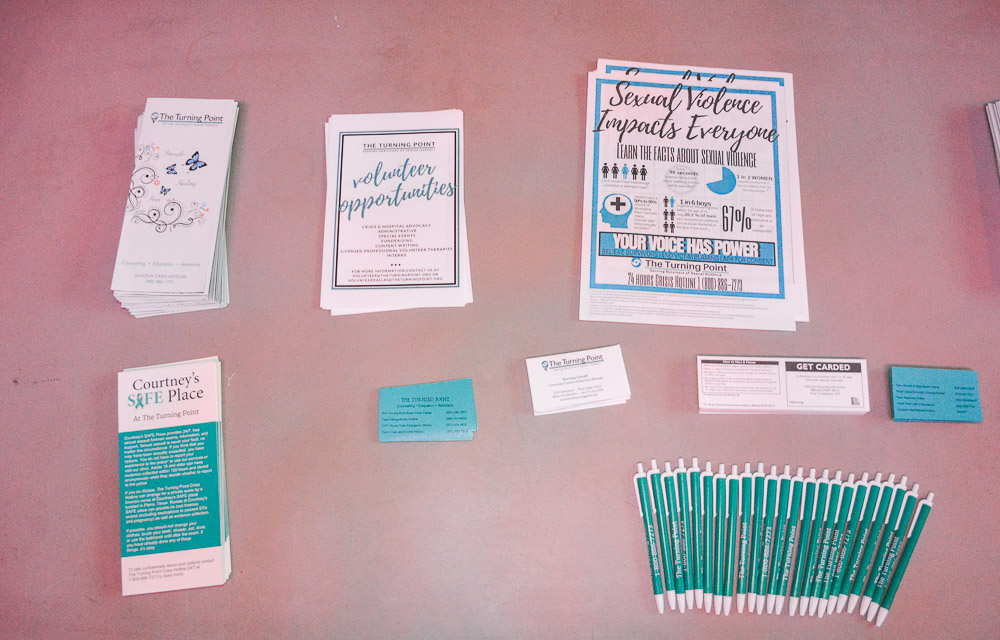THE TURNING POINT table - for donations, awareness, volunteer opportunities and more information on sexual violence.