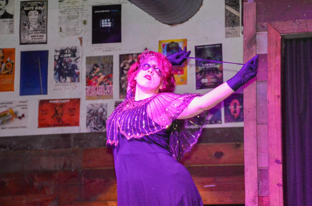 Burlesque dancer Mistress Red Velvet performing.