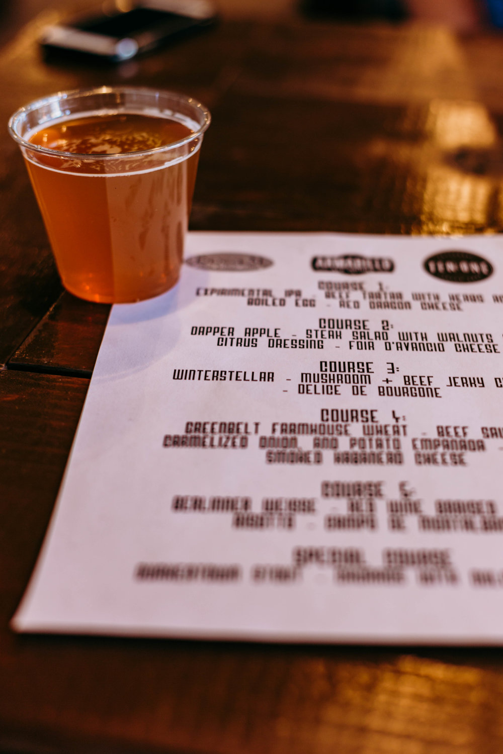 The first beer - the Experimental IPA - and the menu for the night. Photo by Jennifer Meza.