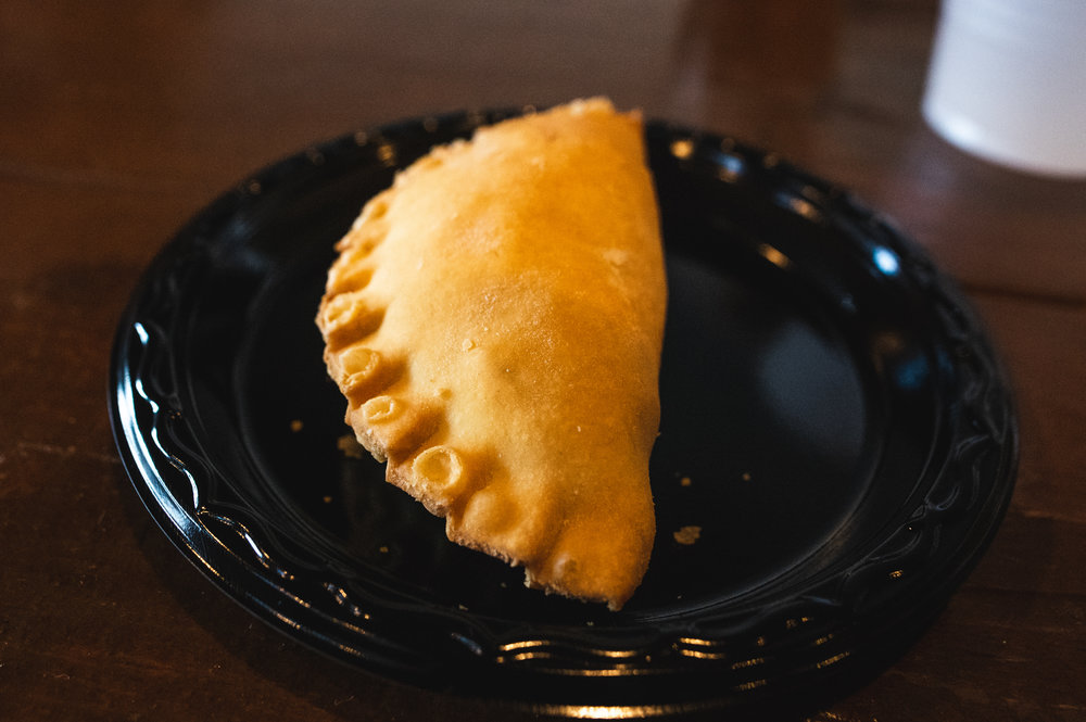 The fourth course, featuring a Sausage, Onion and Potato Empanada with Smoked Habanero Cheese. Photo by Garrett Smith.
