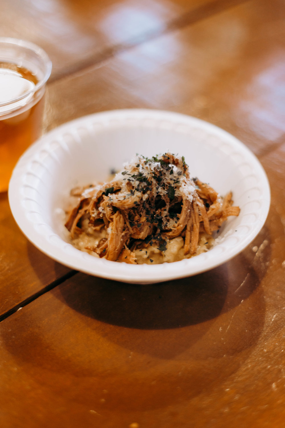 The fifth course, featuring Red Wine Braised Brisket Risotto, topped with Campo de Montalban cheese and paired with Armadillo's Berliner Weisse. Photo by Jennifer Meza.