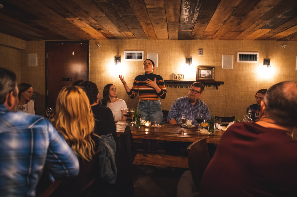 Shelby Hardy, a member of the Barley & Board team, giving a speech.