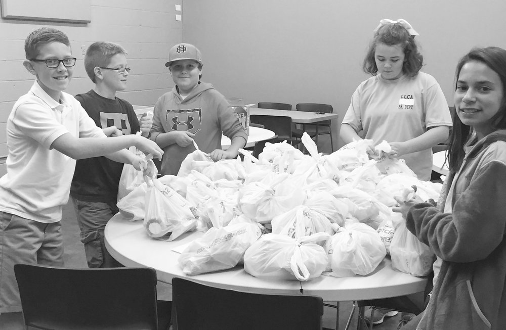 6th graders at First United Methodist Church of Athens filling bags for The Full Tummy Project during their Wednesday Night Activities.