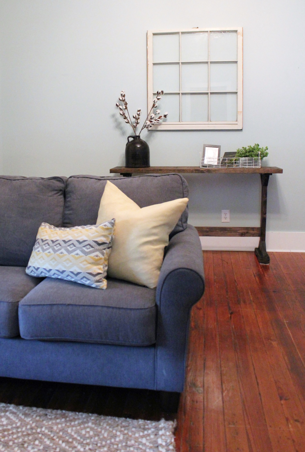 Couch: Rooms for Rent // Pillows: Home Goods // Console Table: Peach & Pine Custom // Window: Flea Market // Rug: Rugsusa.com