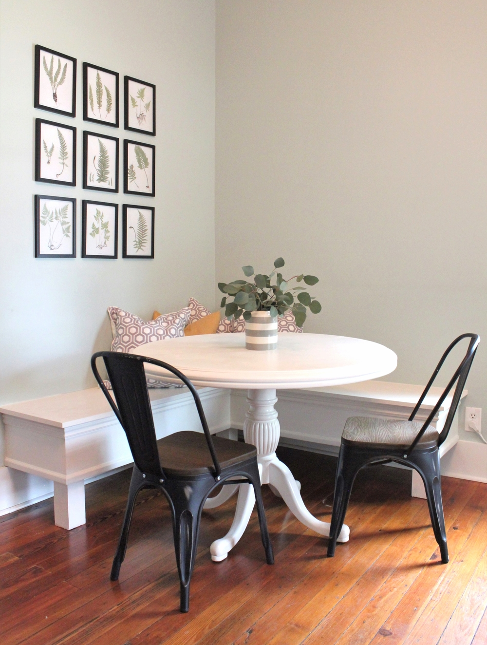Chairs: Wayfair // Banquette: Peach & Pine Custom // Table: Craigslist // Pillows: West Elm // Vase: Target  // Frames: Hobby Lobby // Furniture Paint Color: Dove White by Valspar