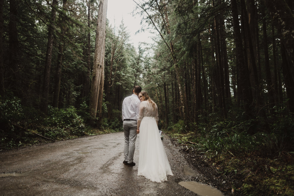 couple walking in the forest, bride and groom walking in the woods, woodsy wedding, washington forest wedding.