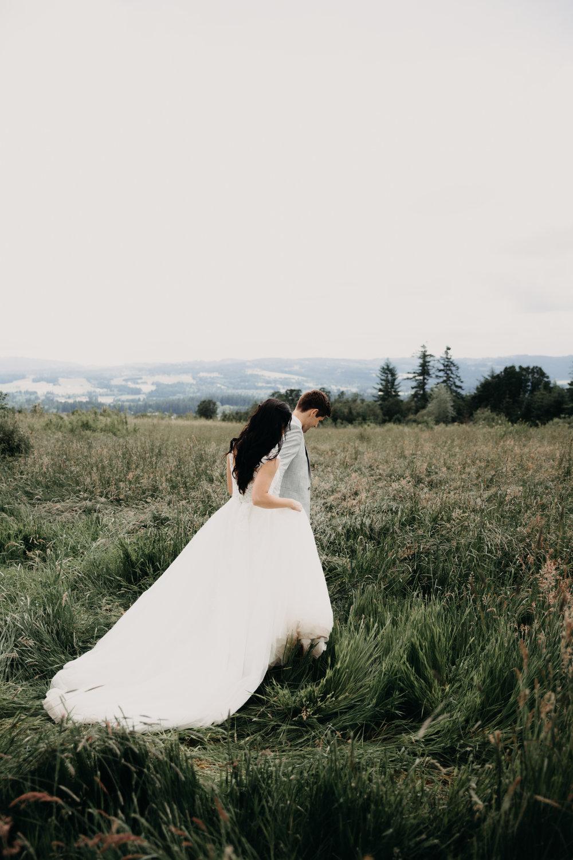 bride and groom walking through a field, bride and groom, pnw bride and groom, portland wedding