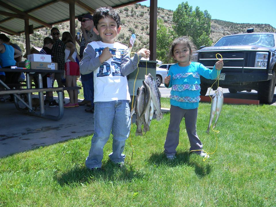 A limit of Rainbow Trout, pictured here is Ein and Samantha Guzman. Samantha won 1st place in the 6yr and under category. under longest trout. Photo courtesy of the Rio Blanco Water Conservancy District