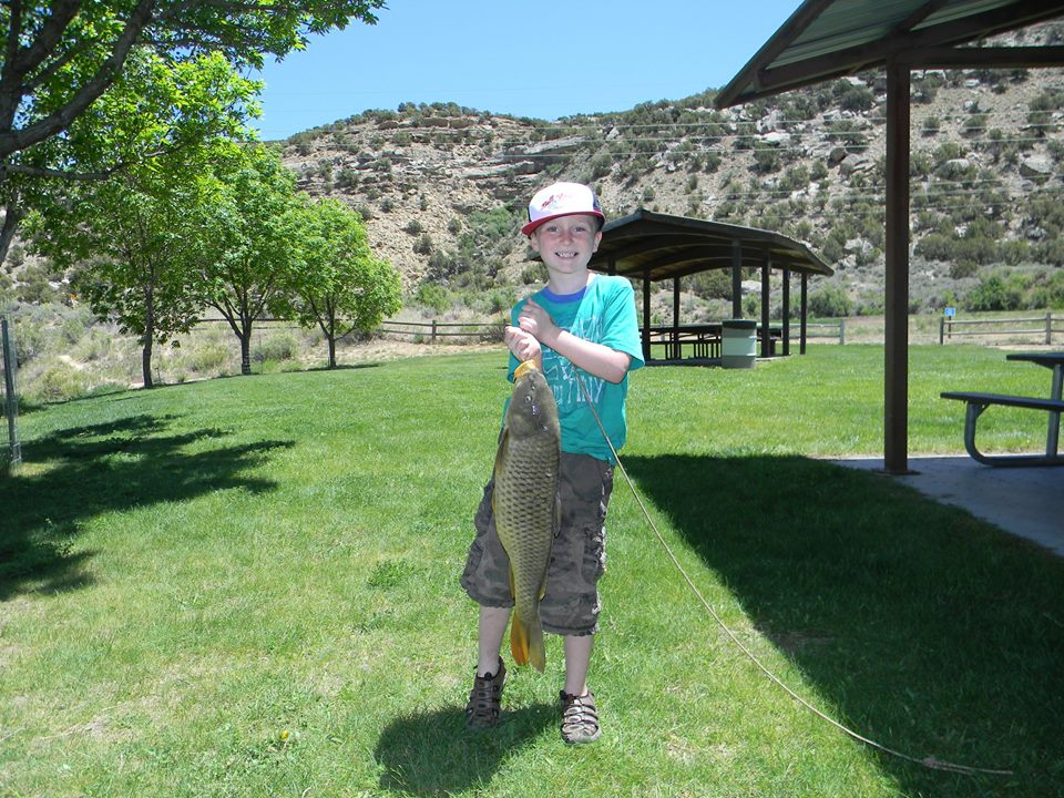 Winner of the 7-10yr old Longest Fishing and Overall Longest Fish category. (Pictured Cash Leischer with his 26.5 inch 8.4# carp) Photo courtesy of the Rio Blanco Water Conservancy District
