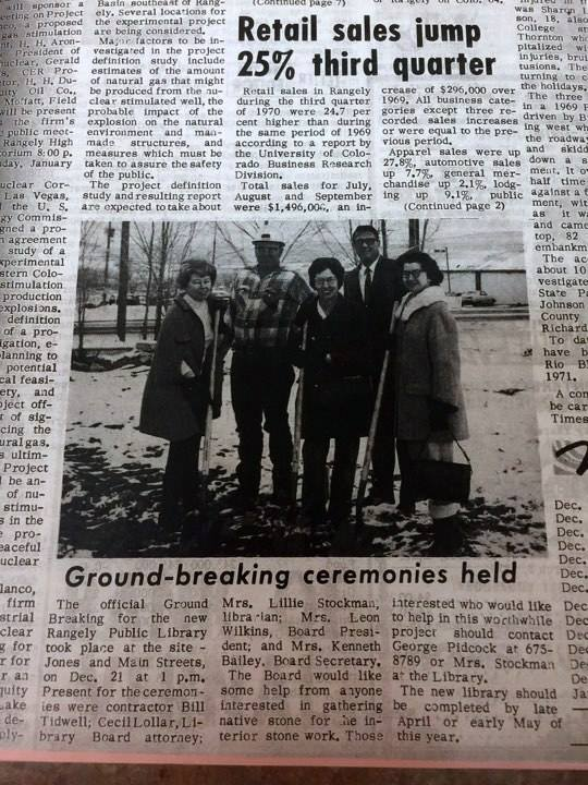 """The caption for the newspaper photograph reads, """"The official Ground Breaking for the new Rangely Public Library took place at the site - Jones and Main Streets, on Dec. 21 at 1 p.m. Present for the ceremonies were contractor Bill Tidwell, Cecil Lollar, Library Board attorney, Mrs. Lillie Stockman, librarian, Mrs. Leon Wilkins, Board President, and Mrs. Kenneth Bailey, Board Secretary. The board would like some help from anyone interested in gathering native stone for the interior stone work. Those interested who would like to help with this worthwhile project should contact George Pidcock, or Mrs. Stockman at the Library. The new library should be completed by late April or early May of this year."""""""