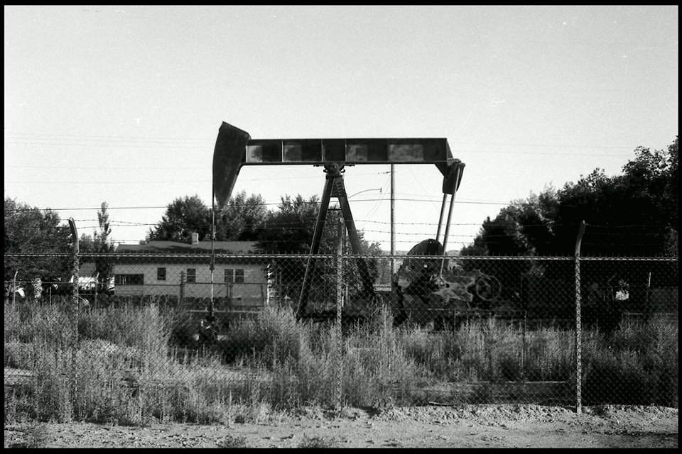 On a spring morning in 1968, Mary Hefley #4 lost her derrick tower. Two years later, the walking beam on her Lufkin pump was replaced with this older one that apparently had spent some time sitting in the mud. The tin Engine House was gone by now, too.