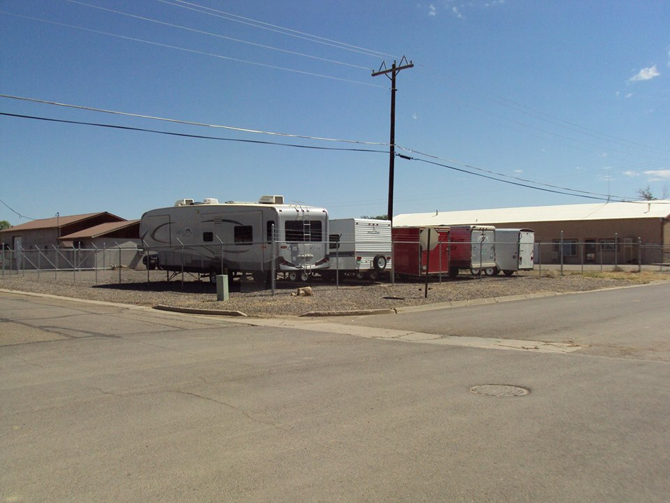 """Today, as the poem, """"Ode to a Place That Doesn't Exist Anymore"""" states, the former site of oil well M.E Hefley #4 is """"a parking lot, where R.V.'s take a nap"""". Note the old garages -- dating clear back to the 1950's -- remain in the background."""