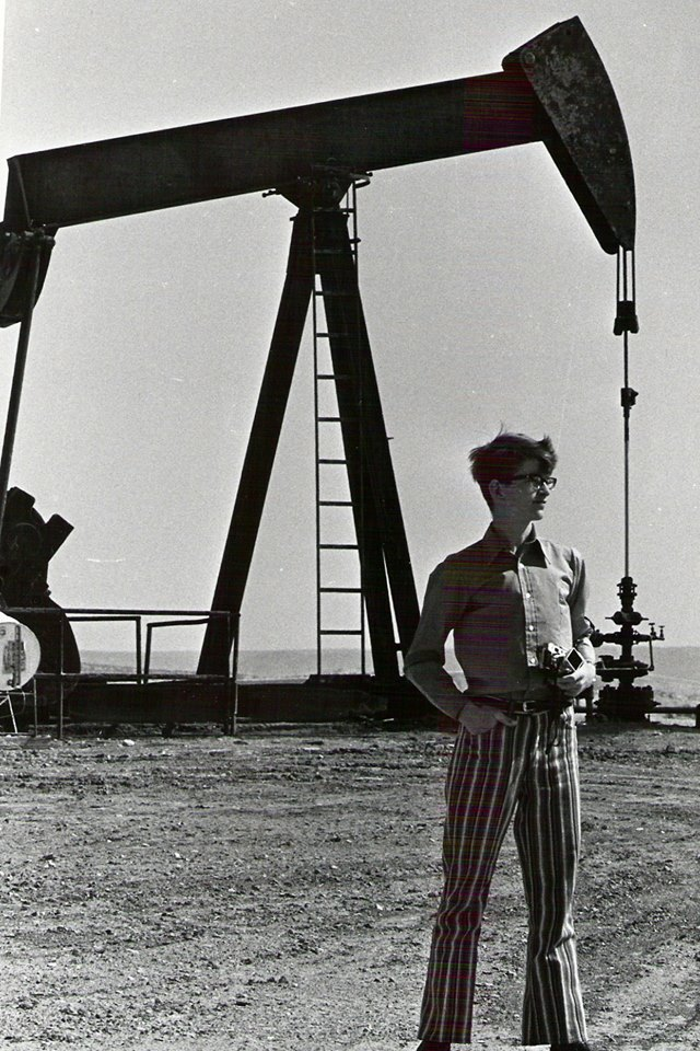 A heroic picture of Oil Geek striking a pose next to the old veteran A1 of the Rangely Oil Field -- except for those pants!! It was the early 1970's, after all, and they wouldn't have garnered a second look at Rangely High School back then. Out in an oilfield? Perhaps another story -- the Geek would not be caught dead in such wear today, in 2018!  (Photo by Bill MItchem, 1972).
