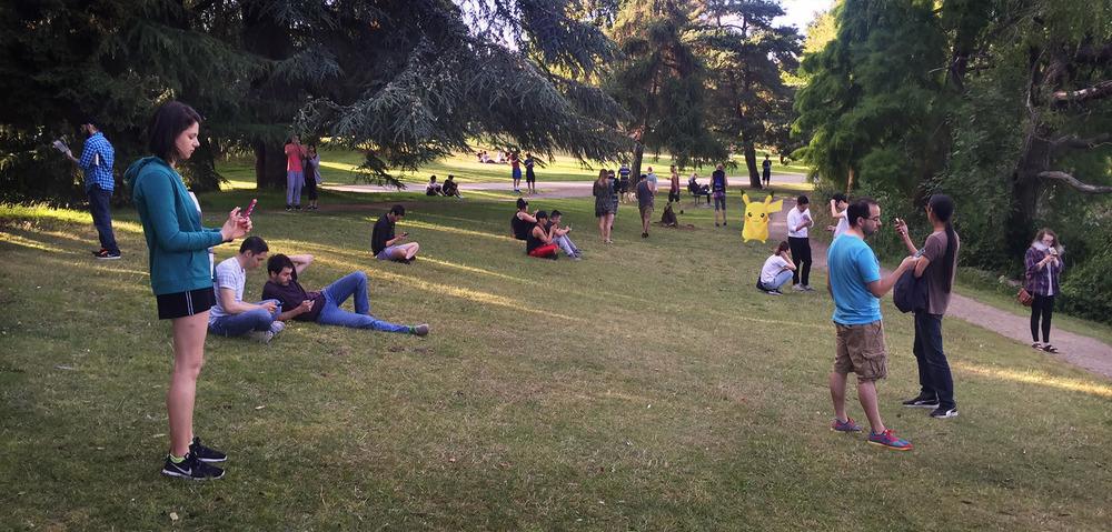 Pokémon GO players gather at a Pokéstop inSeattle's Green Lake Park.
