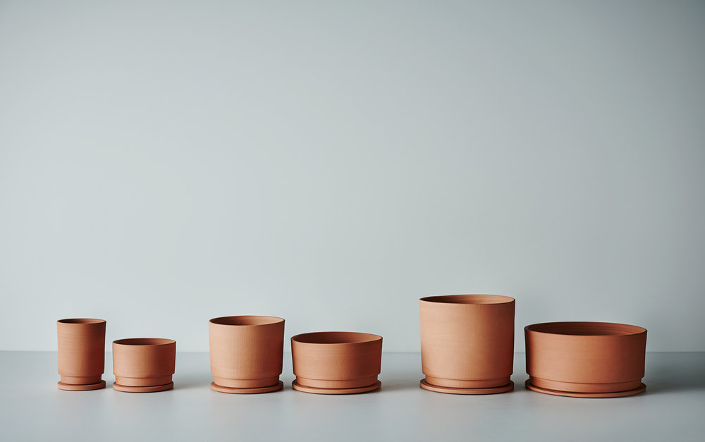 All sizes of Undercut Planters in Terracotta