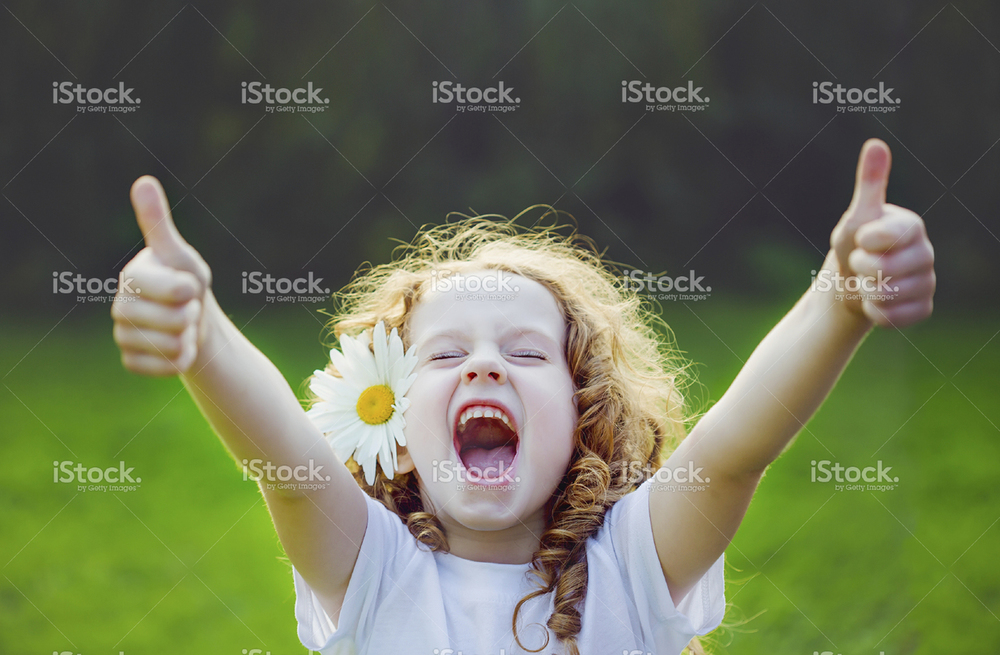 stock-photo-83547003-laughing-girl-showing-thumbs-up-.jpg