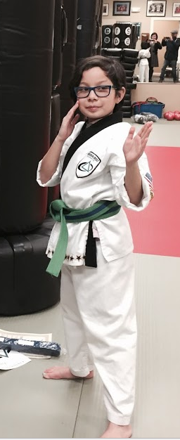"BONUS PHOTO: Middle child (aka ""mini me""), age 7, at advanced green belt"
