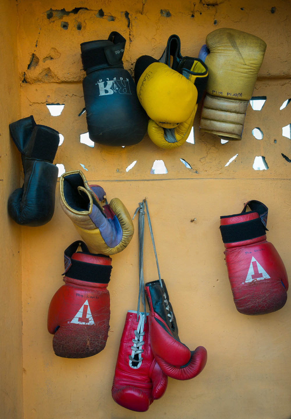 Boxing Gloves hanging at Discipline Boxing Academy, James Town