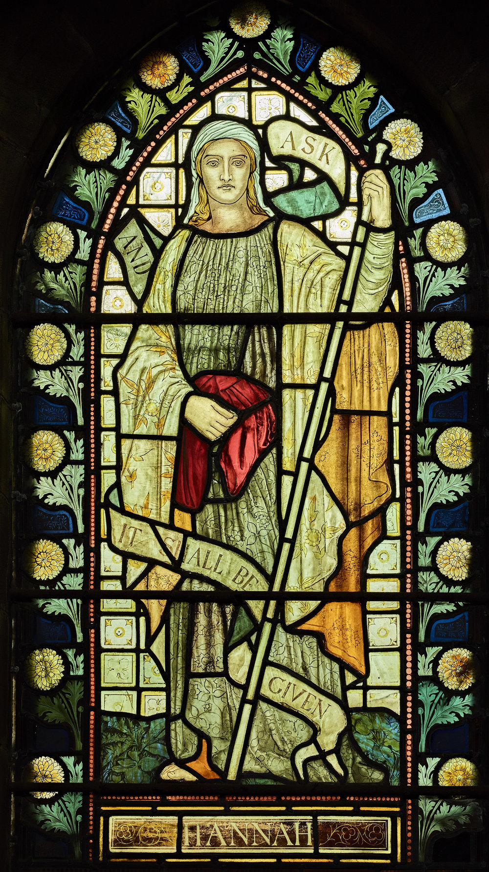 North Isle window depicting Hannah - Dating from 1871-1897 the windows in St Chad's show 27 years of Henry Holiday's developing style, three West windows depicting scenes from the life of Christ, South aisle windows with saints, North aisle windows with women from the Old Testament, four corner windows of Archangels and four East windows, an unusual complete set of church windows by Holiday.