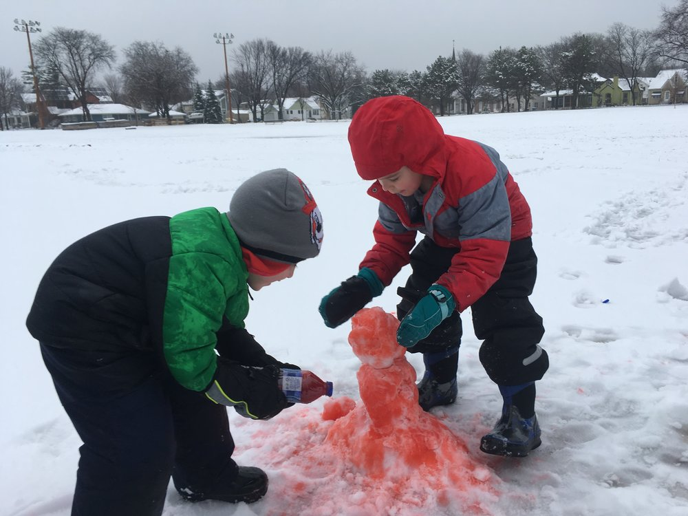 Making snow people with colorful water. We balance free and child-led play with open-ended exploratory questions and organized games.