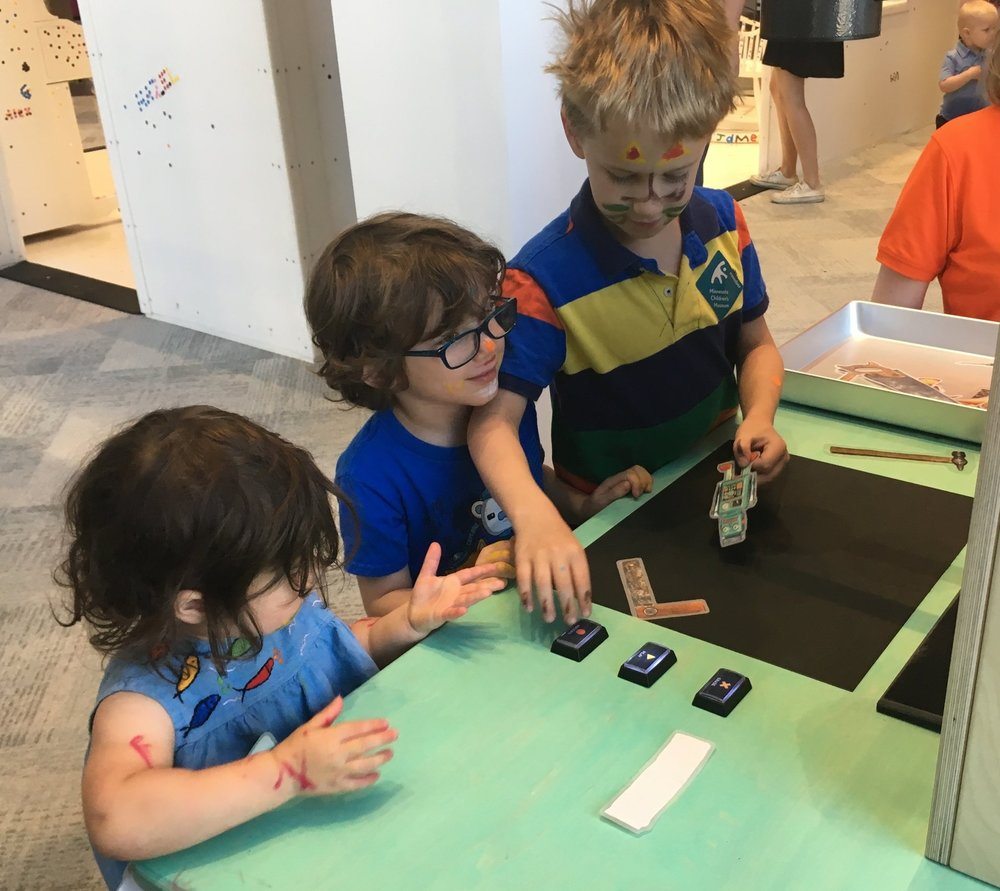 Multi-age play: 2, 4 and 7-year-olds collaborate to create a stop-motion movie.