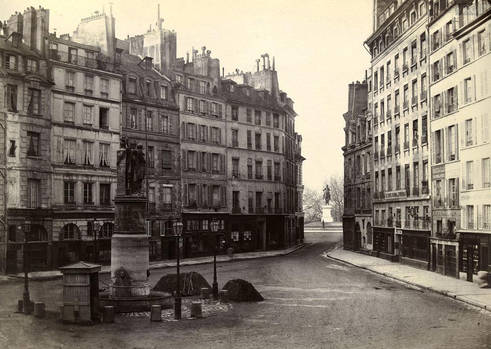 Charles Marville.Place Dauphine, vers le pont Neuf. Paris Ier. Vers 1865. Source:Lien