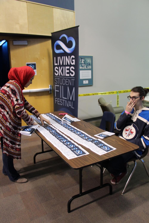 #LSSFF16 volunteers Noor and Brandon getting things ready.