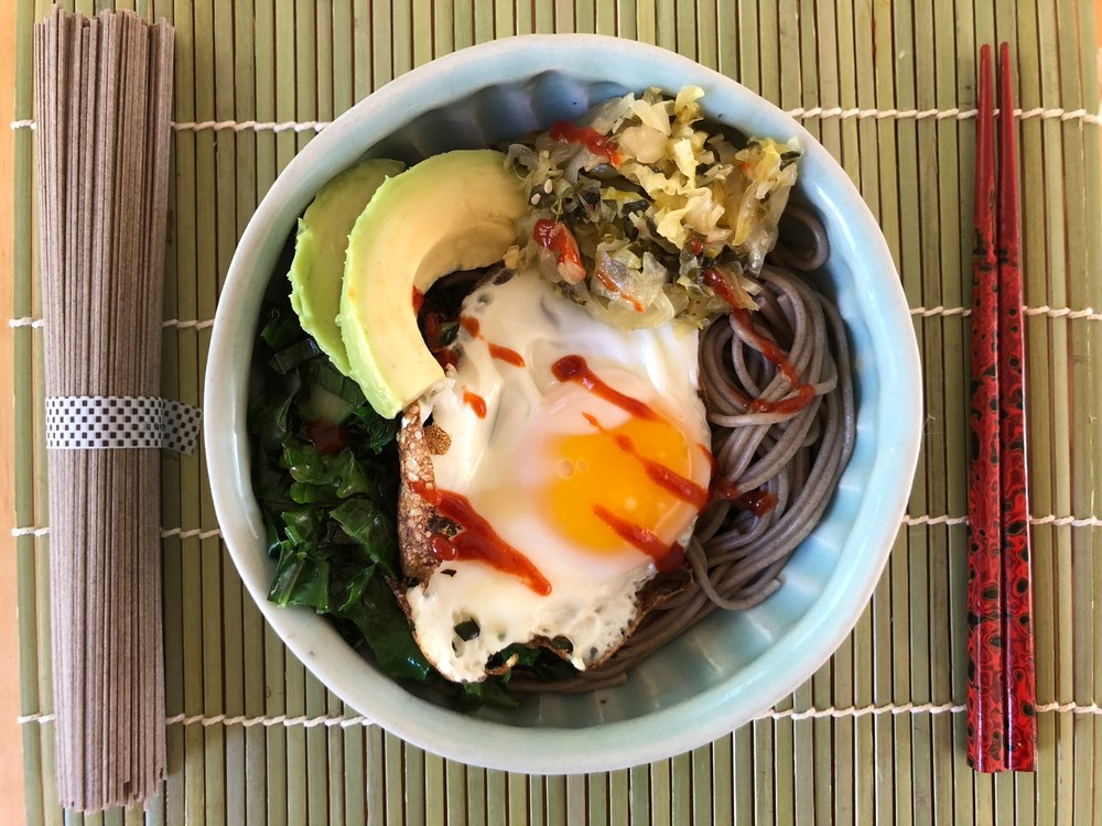 Thai Basil Bok Choy Kimchi Bowl - Cook & drain your favorite noodles (I love buckwheat soba), sauté kale or chard with a little chopped onion, arrange in a bowl with Thai Basil Bok Choy Kimchi, sliced avocado, and a fried egg or two. If you like a bit more heat, top with siracha. Yum.