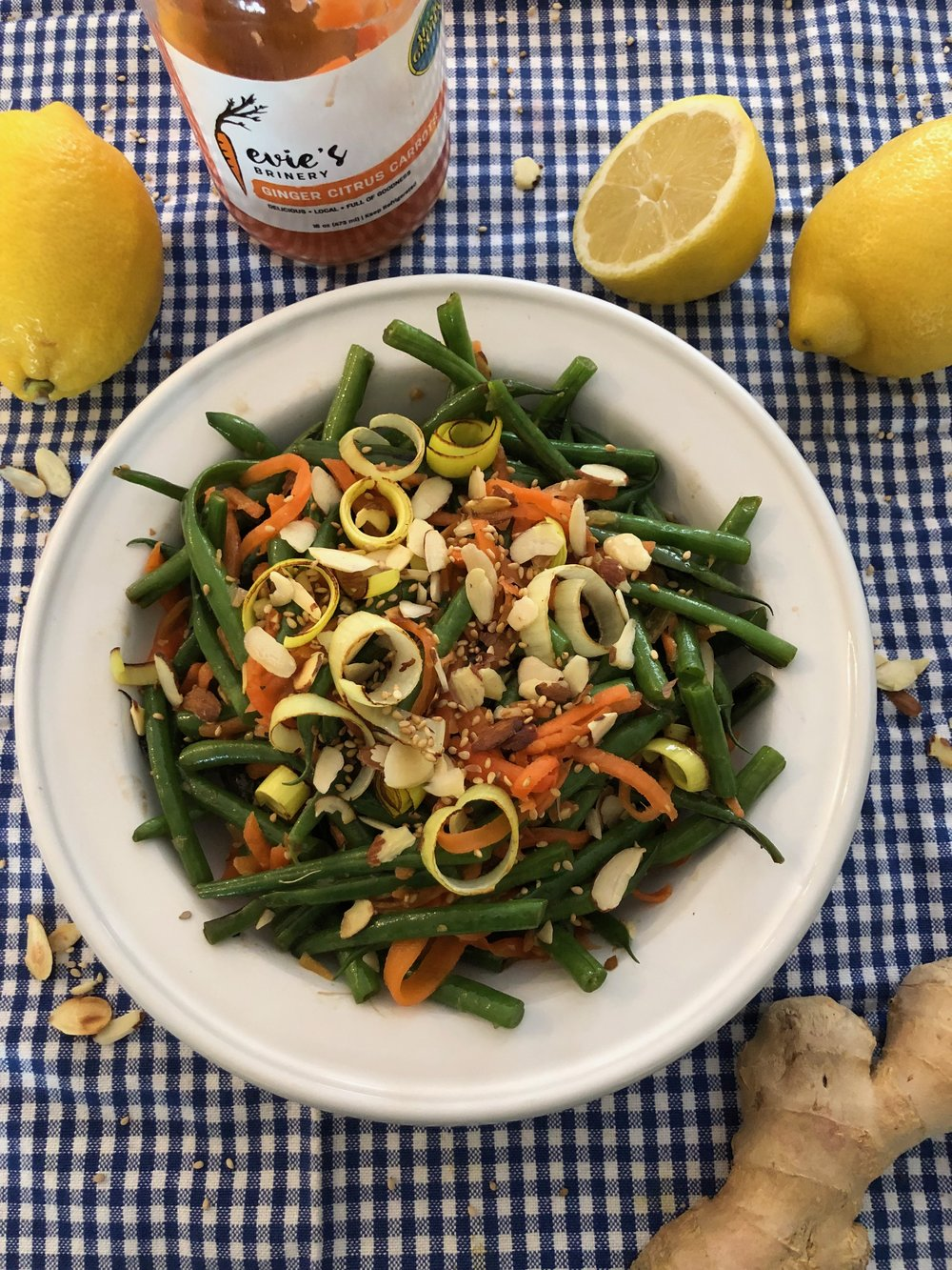 Green beans with Ginger Citrus Carrots - Lightly sauté 2 cups green beans and 1/2 cup sliced leeks in 3-4 Tablespoons toasted sesame oil (add a little garlic if you like), cool, then toss with 1 cup Ginger Citrus Carrots & lemon zest. Top with lightly toasted slivered almonds & sesame seeds. Delicious and so easy!