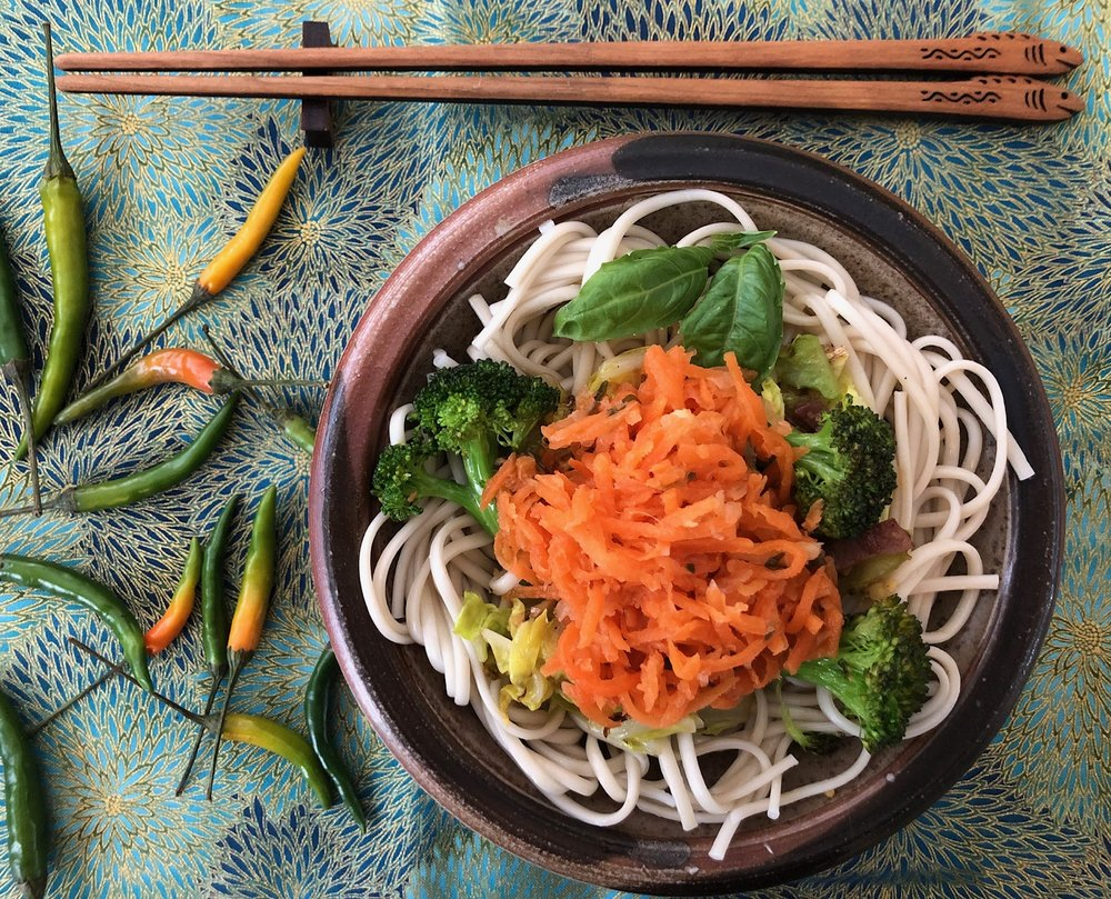 """Thai Chili Lime Longevity Noodles - In honor of Chinese New Year try """"Longevity noodles"""" (which the cook is careful not to break - to ensure longevity).  This is my simple take on the tradition:  Cook Chinese egg noodles (or your favorite Soba, or Thai rice noodle). Add sesame oil to hot pan and stir fry chopped napa cabbage and broccoli, add finely chopped Thai chilies, fresh ginger and a splash each of soy sauce and rice wine.  Top with fermented Carrot Thai Chili Lime and chopped peanuts.  Add chicken, shrimp or tofu for extra protein & goodness!"""