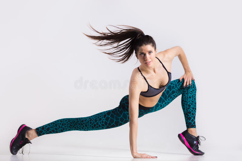 dancer-girl-working-out-one-energetic-attractive-gorgeous-young-fit-modern-woman-aquamarine-sportswear-ponytail-dancing-62411665.jpg
