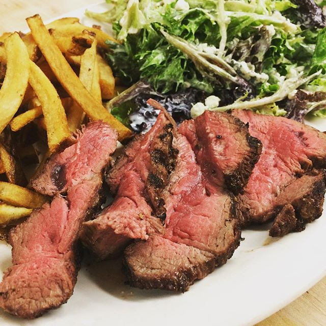 Sliced Flat Iron steak with mesclun lettuce and house cut French fries and a side of horseradish sauce! #TonightsSpecials #lakesidedinning #breezypointinn