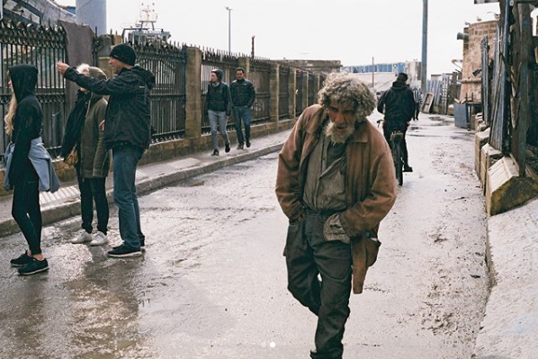 Photo: One of the locals walking along the port, shot by me on 35mm.