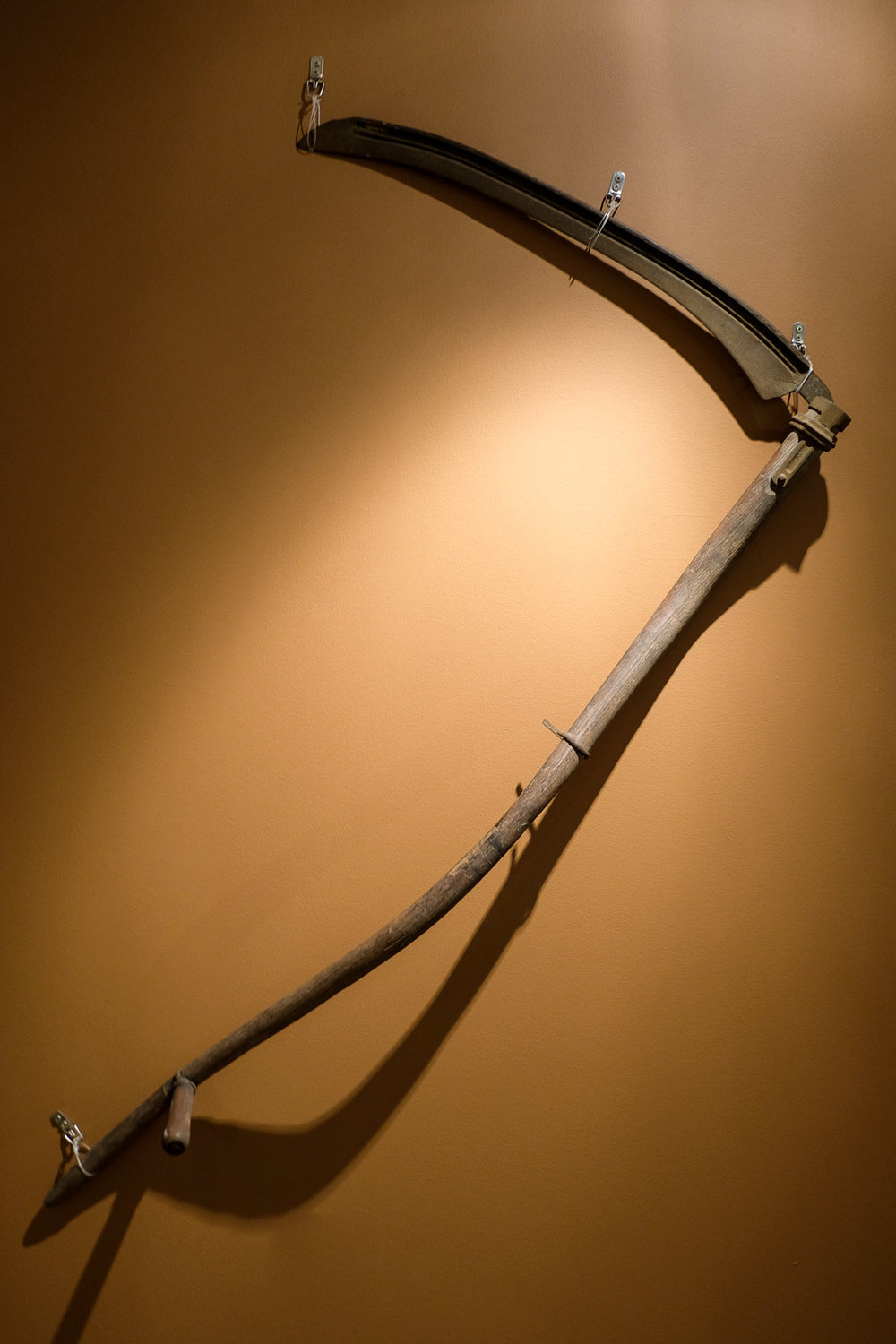 The scythe is a tool used to cut brush or wheat. This scythe belonged to Prince George's County resident Arthur Blackmon. It was purchased by his grandmother Almetta Blackmon in the mid to lat 1940s. The family farmed in the Capitol Heights area.