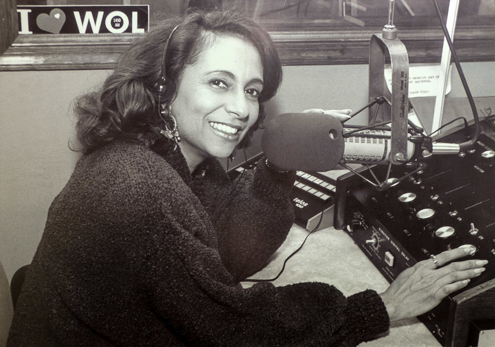"Cathy Hughes in her broadcasting days. WOL was her second stop on the radio dial and the first station she purchased. Her first stop was at WHUR in 1973, where she  increased the station's revenue from $250,000 to $3 million in her first year and created the Quiet Storm format  that featured laid back soul and R&B hits that appealed to single people on Friday and Saturday nights. The Quiet Storm format spread from WHUR to stations across the country and changed urban radio forever. To this day, the Quiet Storm begins on WHUR each evening with Smokey Robinson's ""Quiet Storm"" that inspired the format and gave it its name. If you didn't know this lady's name until now, please do some further reading on her. Cathy Hughes is to radio what Oprah Winfrey is to television. You can hear Ms. Hughes tell her story in her recently-recorded episode of NPR's ""How I Built This"" podcast."