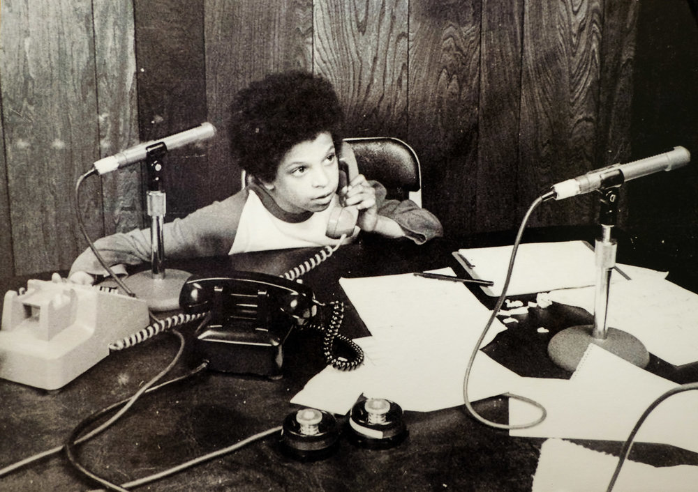 A young Alfred Liggins working the phones at WOL.