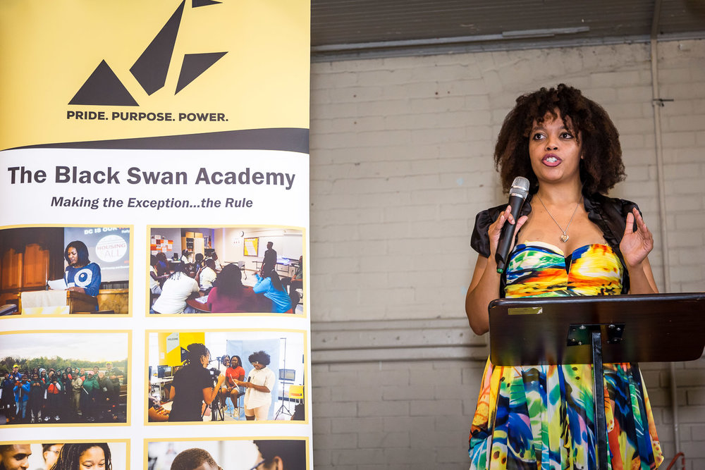 She's way more than just a pretty face. Check out the non-profit she started at  BlackSwanAcademy.org .