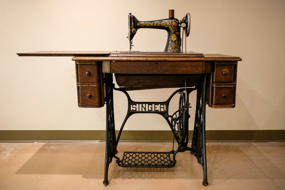 This Singer Sewing machine belonged to Elmira M. Davis. Davis was a dressmaker and practical nurse, operating a custom dress and tailoring shop in North Brentwood. She was born in 1894 and moved to North Brentwood in 1924, where she resided until her passing in June 1977. The sewing machine was inherited by her granddaughter Edith Daley who learned to sew on it as a child.