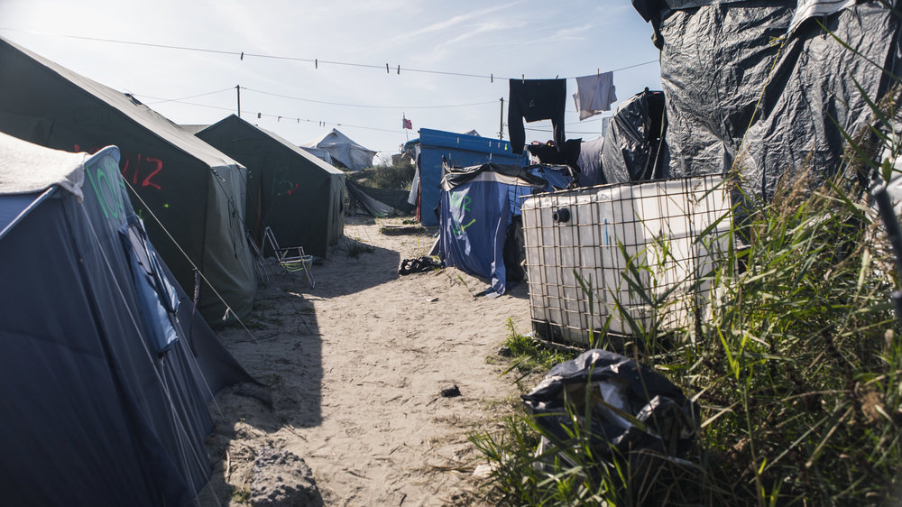 A passage through the residential tents in Calais.
