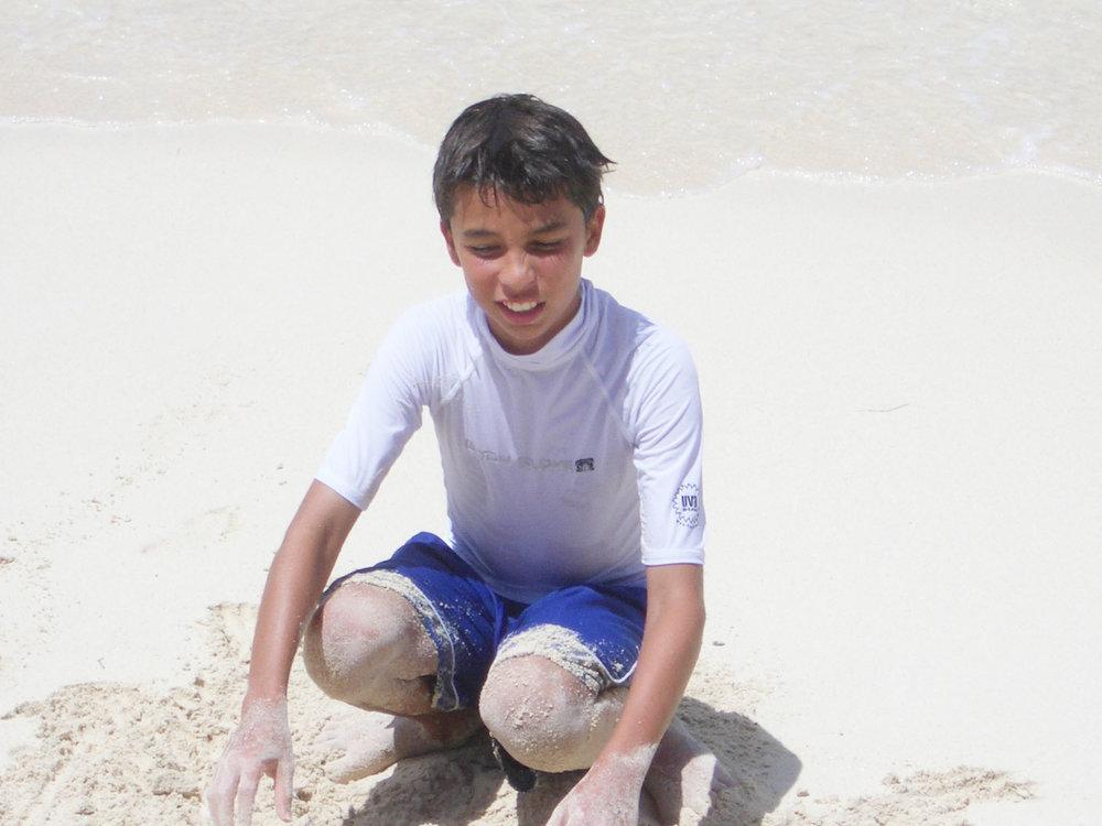 Daniel playing in sand.jpg